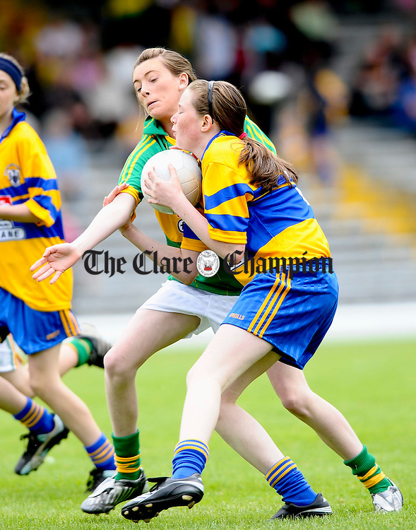 Kerry's Kaelin Fox moves in on Clare's Molly Walsh during their Star Primary Game in Killarney. Photograph by John Kelly.