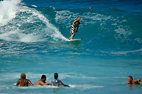 surfer and swimmers during large surf at Magic sands beach Kailua Kona The Big Island of Hawaii
