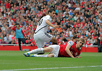 Pictured: Danny Graham of Swansea (TOP) tackled by Per Mertesacker of Arsenal. Saturday 10 September 2011<br />