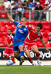 St Johnstone v Real Valladolid....07.08.10  Pre-Season Friendly.Danny Grainger tackles Quique.Picture by Graeme Hart..Copyright Perthshire Picture Agency.Tel: 01738 623350  Mobile: 07990 594431
