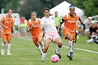 Stephanie Logterman (white) under pressure from Natasha Kai...Saint Louis Athletica defeated Sky Blue FC 1-0 at Anheuser-Busch Soccer Park, Saint Louis, MO.
