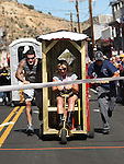 Trailer Trash, right,  beats Runaway Bride during the first round of Outhouse Races in Virginia City, Nev, on Saturday, Oct. 1, 2011. Competition continues Sunday at noon..Photo by Cathleen Allison
