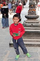 Bodhnath, Nepal.   Young Nepali Boy at the Buddhist Stupa of Bodhnath.
