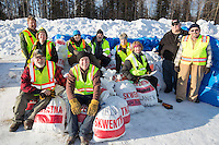 Volunteer loaders pose for a group photo at the Willow, Alaska airport during the Food Flyout on Saturday, February 20, 2016.  Iditarod 2016