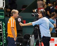 Switserland, Genève, September 18, 2015, Tennis,   Davis Cup, Switserland-Netherlands, Dutch Captain Jan Siemerink is interviewed by Jan-Willem de Lange of Sport 1 TV<br /> Photo: Tennisimages/Henk Koster