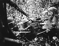Retreating at first into the jungle of Cape Gloucester, Japanese soldiers finally gathered strength and counterattacked their Marine pursuers.  These machine gunners pushed them back.  January 1944.  Brenner. (Marine Corps)<br /> Exact Date Shot Unknown<br /> NARA FILE #:  127-N-71981<br /> WAR & CONFLICT BOOK #:  1186
