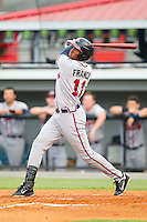 Carlos Franco (11) of the Danville Braves follows through on his swing against the Burlington Royals at Burlington Athletic Park on July 18, 2012 in Burlington, North Carolina.  The Royals defeated the Braves 4-3 in 11 innings.  (Brian Westerholt/Four Seam Images)