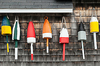 Buoys hung on the facade of a rustic coastal shack, Maine, USA