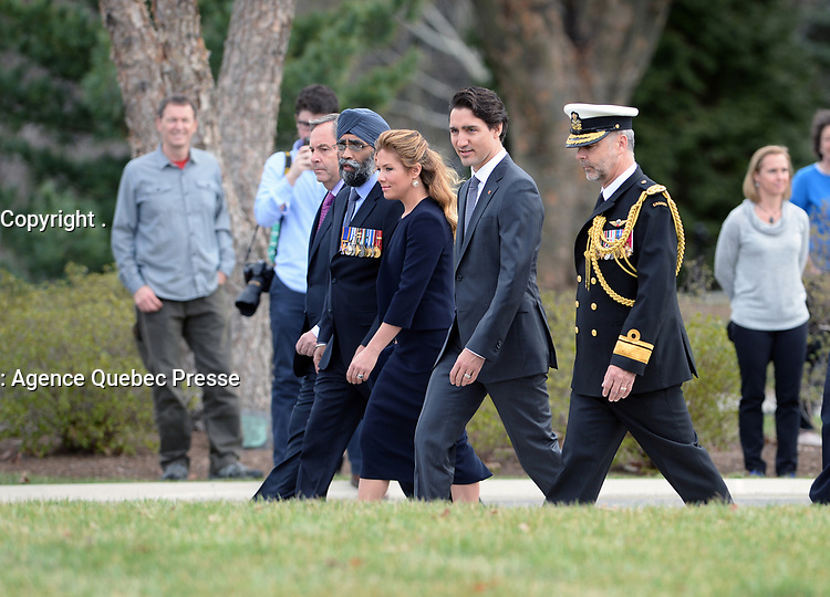 Accompanied by his wife, Sophie Gre'goire-Trudeau, the Right Honorable Justin Trudeau, Prime Minister of Canada, lays a wreath at the Canadian Cross of Sacrifice at Arlington National Cemetery, Arlington, Virginia.  In honor of Prime Minister Trudeau official visit to the United States, The Prime Minister also laid a wreath at the Tomb of the Unknowns.  (Department of Defense photo by Marvin Lynchard)
