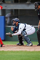 Princeton Rays catcher Roberto Alvarez (13) awaits the pitch in front of home plate umpire Justin Juska during the first game of a doubleheader against the Greeneville Reds on July 25, 2018 at Hunnicutt Field in Princeton, West Virginia.  Princeton defeated Greeneville 6-4.  (Mike Janes/Four Seam Images)