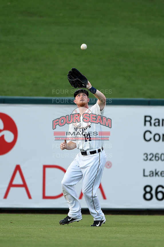 Lakeland Flying Tigers outfielder Raph Rhymes (14) catches a fly ball during a game against the Palm Beach Cardinals on April 13, 2015 at Joker Marchant Stadium in Lakeland, Florida.  Palm Beach defeated Lakeland 4-0.  (Mike Janes/Four Seam Images)