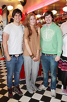 """NO REPRO FEE. 26/5/2011. NEW EDDIE ROCKET'S SHAKE SHOP. Sam Walsh, Sarah Foley and Josh Buckningham are pictured in the new Eddie Rocket's Shake Shop. The design seeks to recall the vintage milkshake bars from 1950's America and re-imagine them for the 21st century. The new look aims to appeal to both young and old with a quirky and bold colour scheme and a concept of make-your-own milkshakes, based on the tag line """"You make it...We shake it!"""". Eddie Rocket's City Diner in the Stillorgan Shopping Centre in south Dublin has re-opened after an exciting re-vamp and the addition of a Shake Shop. Ten new jobs have been created with the Diner's re-launch bringing the total working in Eddie Rocket's Stillorgan to 30. Picture James Horan/Collins Photos"""