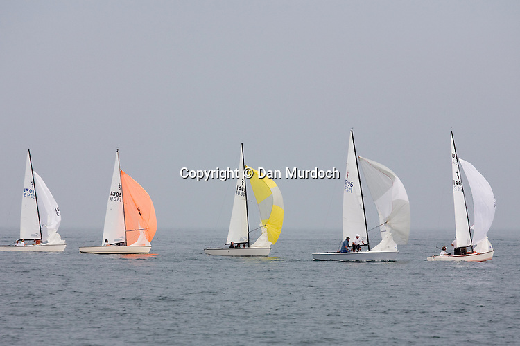 Lightning sailboats racing with spinnakers set