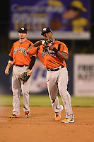 Bowie Baysox shortstop Sharlon Schoop (22) throws to first as Buck Britton (5) backs up the play during a game against the Binghamton Mets on August 3, 2014 at NYSEG Stadium in Binghamton, New York.  Bowie defeated Binghamton 8-2.  (Mike Janes/Four Seam Images)