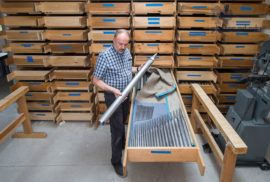 Fritts examines a pipe in one of the drawers where thousands lie waiting for their trip to Notre Dame. The Wayne and Diana Murdy Family Organ at the Basilica of the Sacred Heart will boast 5,164 pipes. Those too large to fit in drawers stand lashed to the workshop's walls.