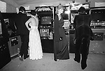 Playing Space Invaders machine at the Berkeley Square Ball. London 1981.
