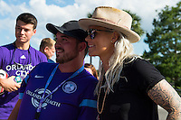 Orlando, Florida - Thursday, June 23, 2016: Orlando Pride goalkeeper Ashlyn Harris (1) takes a selfie with a fan prior to a National Women's Soccer League match between Orlando Pride and Houston Dash at Camping World Stadium.