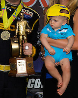 Sept. 1, 2014; Clermont, IN, USA; Hunter Lucas , son of NHRA top fuel driver Morgan Lucas looks at the Wally trophy won by driver Richie Crampton during the US Nationals at Lucas Oil Raceway. Mandatory Credit: Mark J. Rebilas-USA TODAY Sports