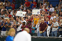 Peoria Chiefs give a standing ovation for a moment remembering Cpl Ben Desilts during a game against the Wisconsin Timber Rattlers on August 21, 2015 at Dozer Park in Peoria, Illinois.  Wisconsin defeated Peoria 2-1.  (Mike Janes/Four Seam Images)