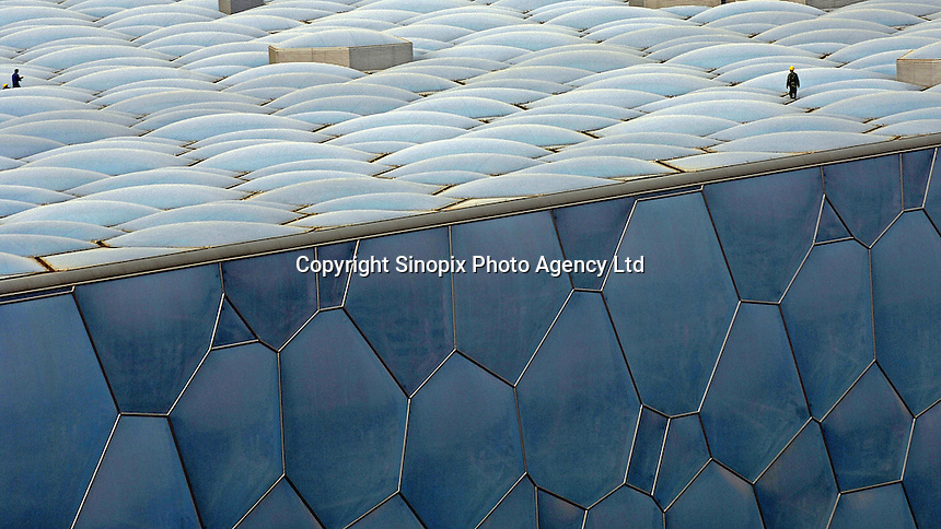 "The exterior of the National Swimming Center, also dubbed the ""Water Cube"", designed by PTW Architects from Sydney, Australia and CSCEC International Design and Arup, under construction in Beijing, China. Beijing has been elected the Host City of the 2008 Olympic Games..30 Apr 2007"