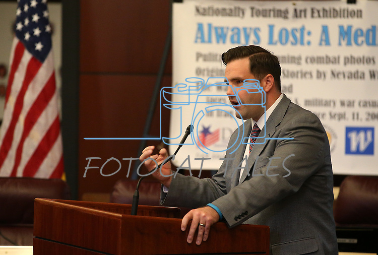 Nevada Director of Military and Veterans Policy Caleb Cage speaks at the opening ceremony of the Always Lost: A Meditation on War exhibit at the Legislative Building in Carson City, Nev., on Monday, April 6, 2015. <br /> Photo by Cathleen Allison/Nevada Photo Source