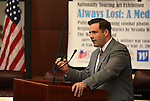 Nevada Director of Military and Veterans Policy Caleb Cage speaks at the opening ceremony of the Always Lost: A Meditation on War exhibit at the Legislative Building in Carson City, Nev., on Monday, April 6, 2015. <br />