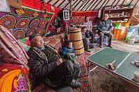 Asia Mongolia, Altai mountain,SBugat Soum,, the hunter ,75 old Karmenkhan inhis ger