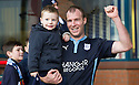 Dundee's David Clarkson with his son Josuha at the end of the game.