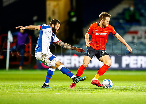 21st November 2020; Kenilworth Road, Luton, Bedfordshire, England; English Football League Championship Football, Luton Town versus Blackburn Rovers; Rhys Norrington-Davies of Luton Town breaks away from a tackle.