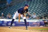 Northwest Arkansas Naturals relief pitcher Reid Redman (12) looks in for the sign during a game against the Midland RockHounds on May 27, 2017 at Arvest Ballpark in Springdale, Arkansas.  NW Arkansas defeated Midland 3-2.  (Mike Janes/Four Seam Images)