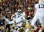 FSU wide receiver Kelvin Benjamin catches a pass in heavy traffic in the BCS national title game at the Rose Bowl in Pasadena, California on January 6, 2014.  Florida State Seminoles defeated the Auburn Tigers 34-31.