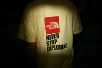 CHINA. Beijing. The back of a man's shirt near the Olympic village during the Beijing 2008 Summer Olympics. 2008