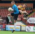 Partick's John Baird goes in high and late on Ayr keeper David Hutton