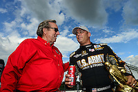 Sept 9, 2012; Clermont, IN, USA: NHRA top fuel dragster driver Tony Schumacher (right) celebrates with team owner Don Schumacher after winning the US Nationals at Lucas Oil Raceway. Mandatory Credit: Mark J. Rebilas-