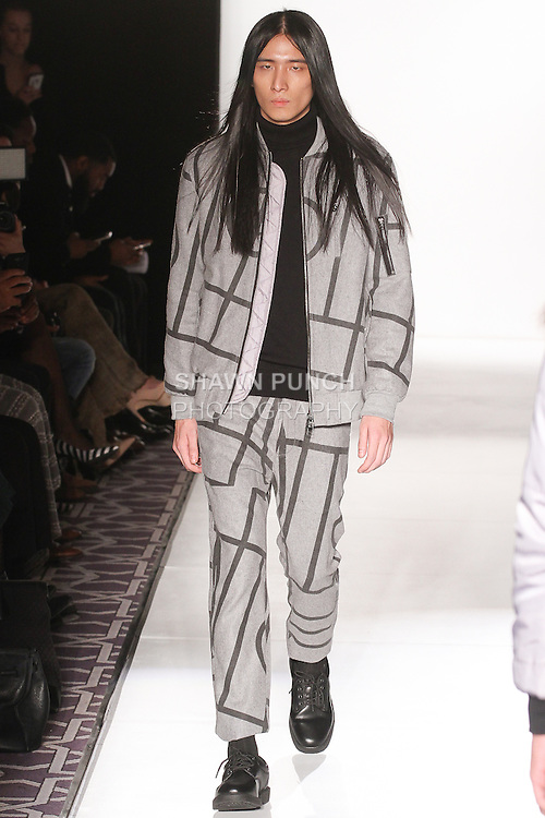 """Model walks runway in an outfit from the GRAA Fall 2015 """"Home Court"""" collection by Benjamin Martinsen and Filip Wibe, during the Pret-A-Porter Fall 2015 fashion show for  Fashion Gallery New York Fashion Week Fall 2015."""