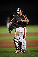 Aberdeen IronBirds relief pitcher Zach Matson (55) celebrates with catcher Alfredo Gonzalez (19) after the final out a game against the Staten Island Yankees on August 23, 2018 at Leidos Field at Ripken Stadium in Aberdeen, Maryland.  Aberdeen defeated Staten Island 6-2.  (Mike Janes/Four Seam Images)