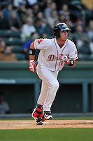 Catcher Austin Rei (13) of the Greenville Drive runs toward first base in a game against the Asheville Tourists on Thursday, April 7, 2016, at Fluor Field at the West End in Greenville, South Carolina. Greenville won, 4-3. (Tom Priddy/Four Seam Images)