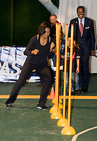 First Lady Michelle Obama runs a speed drill during a US Soccer Foundation clinic held at City Center in Washington, DC.