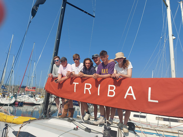 """""""Sailing School With a Difference"""" - the WIORA-winning Tribal Youth Initiative at Fenit on Tralee Bay with (left to right) David Carberry, Cormac Donnelly, Justin Mitchel Ward, Jack Nolan, Liam Burke (Skipper), Ronan Shepard and Olivia Cure."""
