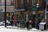 Toronto (ON) CANADA,  April , 2008-.Pedestrians walk beside a STARBUCK (tm) Coffe shop on Yonge street and College....