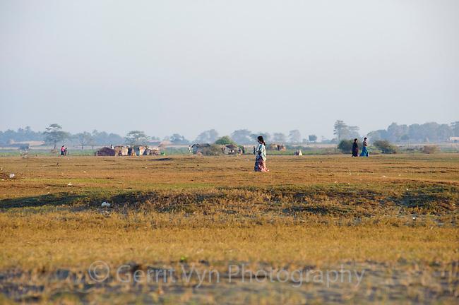 Rakhine women on a morning walk near the village Magyichaung. Rakhine State, Myanmar.