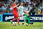 Lucas Alario of Argentina (C) attempts a kick while being defended by Izwan Mahbud of Singapure (R) during the International Test match between Argentina and Singapore at National Stadium on June 13, 2017 in Singapore. Photo by Marcio Rodrigo Machado / Power Sport Images