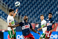 FOXBOROUGH, MA - AUGUST 26: Cesar Murillo #4 of Greenville Triumph SC and Mayele Malango #10 of New England Revolution II battle for head ball during a game between Greenville Triumph SC and New England Revolution II at Gillette Stadium on August 26, 2020 in Foxborough, Massachusetts.