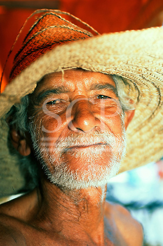 Cachoeiro, Bahia State, Brazil. Man of mixed race (mulato) wearing an old straw hat.
