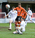 :: MOTHERWELL'S TOM HATELEY CLEARS JUST AS DUNDEE UTD'S DAVID GOODWILLIE PREPARES TO SHOOT  ::