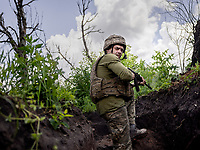 Victor (20) keeps watch from a trench where Ukrainian government forces are just 200 metres from their enemy, Russian-backed separatists. At all times the soldiers must be alert as snipers are very active in the area and shelling is common too.
