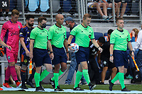 ST PAUL, MN - JULY 18: Game officials walk out prior during a game between Seattle Sounders FC and Minnesota United FC at Allianz Field on July 18, 2021 in St Paul, Minnesota.