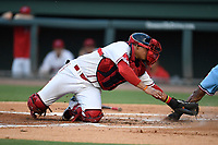 Catcher Isaias Lucena (19) of the Greenville Drive stretches to apply the tag during a game against the Hickory Crawdads on Monday, August 20, 2018, at Fluor Field at the West End in Greenville, South Carolina. Hickory won, 11-2. (Tom Priddy/Four Seam Images)