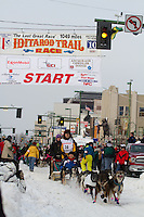 2010 Iditarod Ceremonial Start in Anchorage Alaska musher # 30 MIKE SUPRENANT with Iditarider