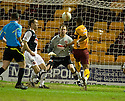 ::  MOTHERWELL'S CHRIS HUMPHREY'S SHOT TAKES A DEFLECTION OFF DUNDEE UTD'S SEAN DILLON'S BOOT BEFORE GOING IN FOR MOTHERWELL'S SECOND  ::.06/04/2011 sct_jsp_012_motherwell_v_dundee_utd     .Copyright  Pic : James Stewart.James Stewart Photography 19 Carronlea Drive, Falkirk. FK2 8DN      Vat Reg No. 607 6932 25.Telephone      : +44 (0)1324 570291 .Mobile              : +44 (0)7721 416997.E-mail  :  jim@jspa.co.uk.If you require further information then contact Jim Stewart on any of the numbers above.........